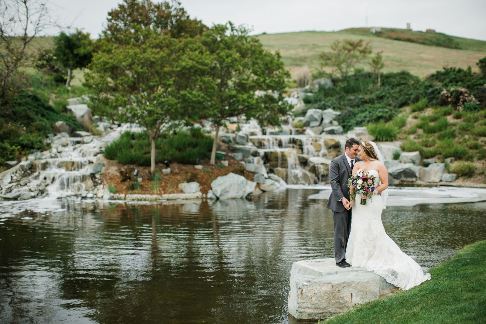 Wedding couple in front of Water Feature Dublin Ranch Golf Course